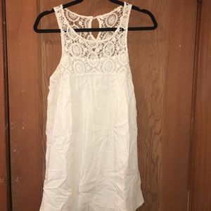 Beautiful white flowy dress with lace detailing